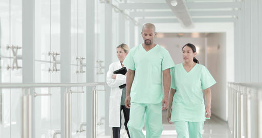 Surgeons walking through a hospital Footage