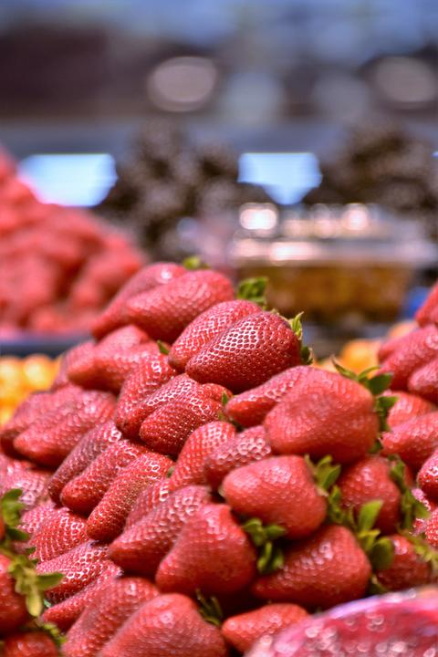 Pile of Strawberries on the pallet Photo