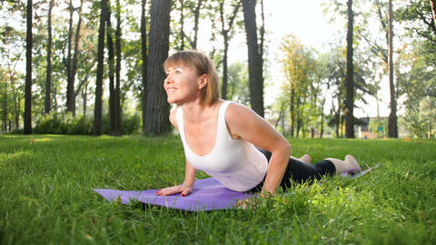 4k footage of middle aged woman exercising in park. Adult... Stock Video Footage