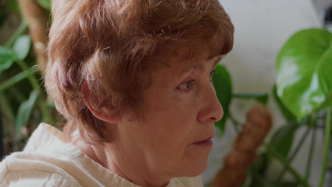 Senior woman browsing internet, looking to screen, close-up Footage
