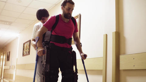 Disable man walking in the robotic exoskeleton Footage