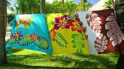 Sarong skirts handmade hanging in Tahiti, French Polynesia wrap hanging Live Action