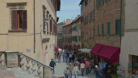 People walking in a main street of Montepulciano, in slowmoton and 4k GIF