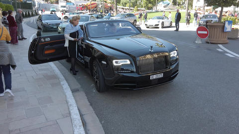 Rich Swiss Seniors In A Luxury Rolls-Royce Dawn Live Action