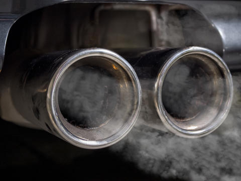 Close up of smoking car exhaust Photo