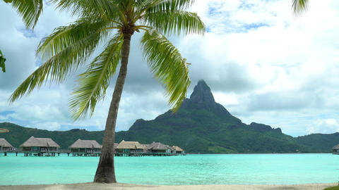 Tropical vacation paradise island overwater bungalows hotel resort on Bora Bora Footage