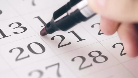 Marking the twenty-first 21 day of a month in the calendar with a red marker Footage