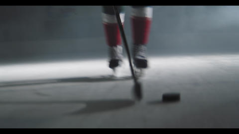 hockey players fight for puck on ice arena at game closeup GIF