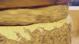 Close-up shot of millstone grinding wheat Footage