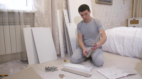 Man assembling box at home Footage