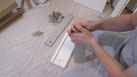 Man assembling furniture at home Footage