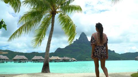 French Polynesia Vacation Travel woman walking on paradise motu beach Bora Bora Footage