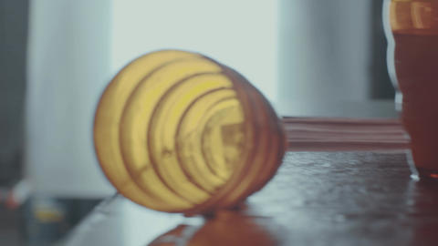 Orange glass bowls over edge of wet kitchen desk in early morning Footage