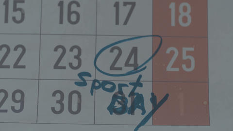 Part of calendar sheet with marked date as sport day with blue marker pen Footage