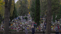 Poland. People are visiting cemetery at All Saints' Day at dusk Footage