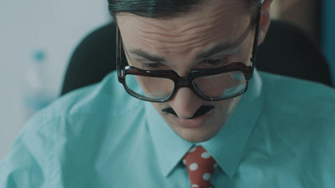 Young male office clerk in enormous glasses and funny mustaches yawning Live Action