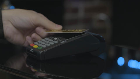 Close-up shot of person using mobile payment PayPass Footage
