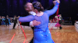 Ballroom dancing. Anonymous defocused people dancing standard dances. Slow motion Live Action