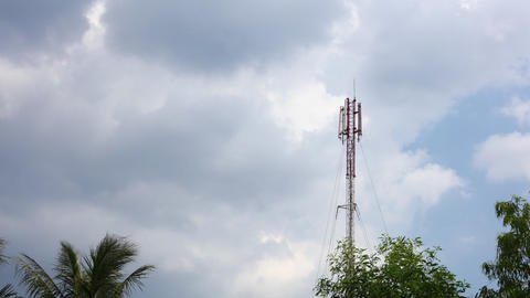 Network communication tower mast cloudscape and treetops Footage