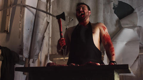 Maniac murder covered in blood in abandoned building… Stock Video Footage