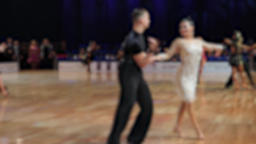 Anonymous defocused people dancing latin dances.Ballroom dancing Live Action