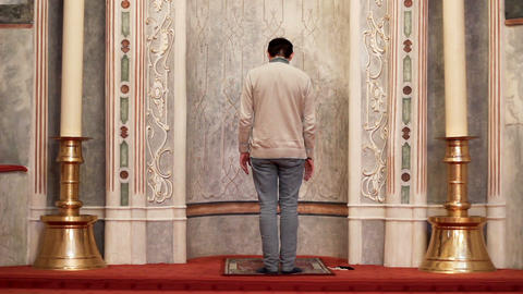 Religious young muslim praying in the mosque Footage