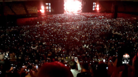 4k blurred footage of big rock concert on big stadium at night. People dancing Footage