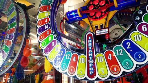 4k footage of colorful round display at slot machine in amusement park Footage