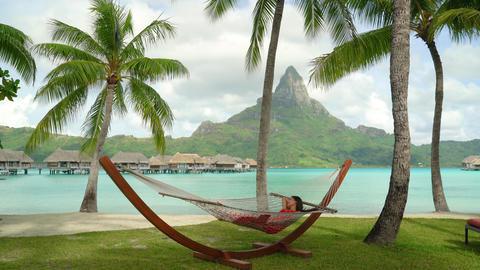Vacation - woman relaxing in hammock on Bora Bora Tahiti travel paradise Footage