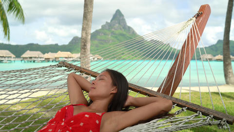 Vacation Relaxation in travel paradise. Happy smiling woman relaxing in hammock Live Action