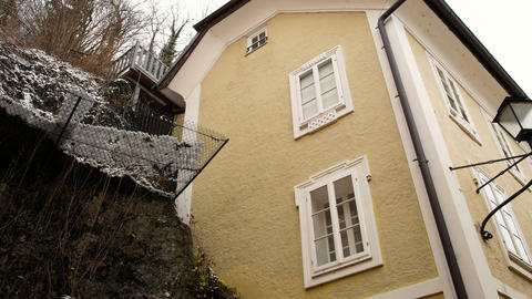 house near a rock face in Salzburg, winter time Footage