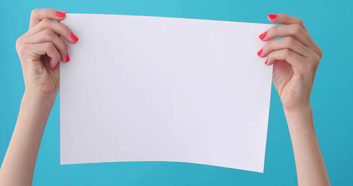 finger points on blank sheet of paper in female hand Footage