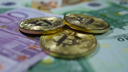Bitcoins , Golden bitcoins and real money Footage