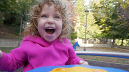 Happy child on a carousel Footage