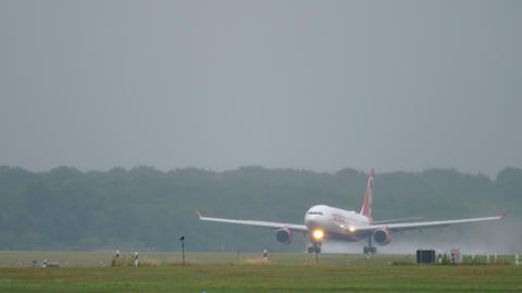 Airplane landing at rainy weather Footage