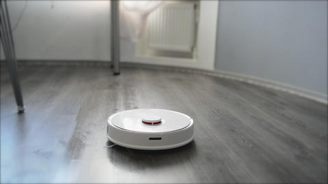 Smart robot vacuum cleaner makes wet cleaning of the laminated floor Footage