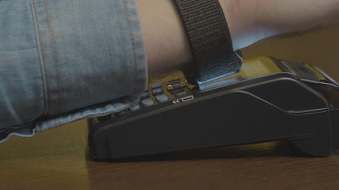 Short view of Young Man in cafe is paying the price by using a smart watches and Footage