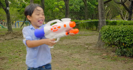 happy children playing with water guns on summer Archivo