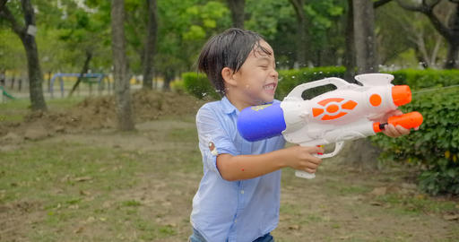 [alt video] happy children playing with water guns on summer