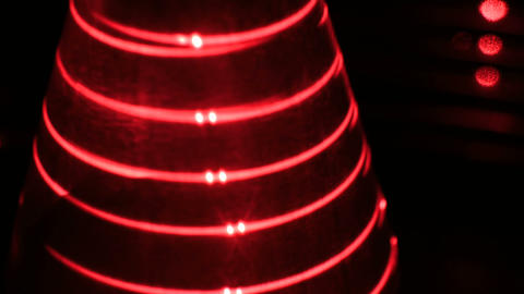Optical illusion with red lasers and geometric object Footage