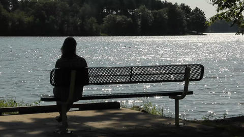 Quiet woman by the lake Footage