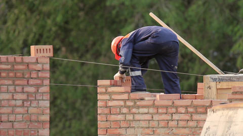 The bricklayer building a brick wall Footage