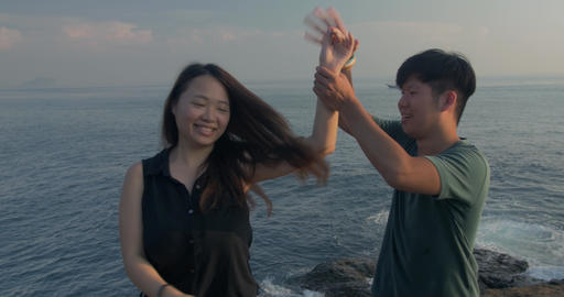 Young Couple dance beautiful location on coast o taiwan- 2 ビデオ