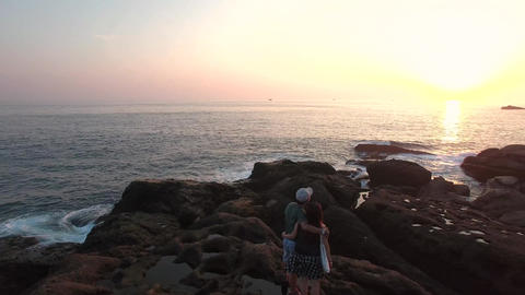 Circling Aerial Shot young Taiwanese couple watching sunset in Taiwan beautiful ビデオ