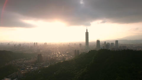 Inspiring drone aerial shot of Taipei city Skyline bright sun light at Sun down Footage