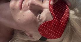Sleeping woman wearing blindfold sleep mask Live Action