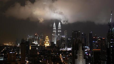 Kuala Lumpur CIty Skyline at Night with Thunderstorm and Lightning Footage