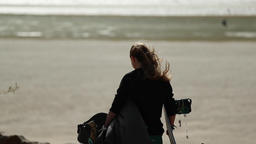 Young Woman with Kiteboarding Equipment Walking Towards Sea Footage