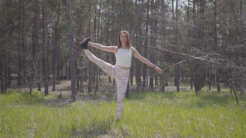 Healthy beautiful woman doing yoga fitness stretching in the forest. Spectacular Footage