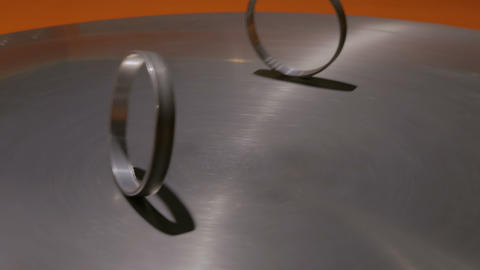Moving rings on metal turning surface at technology museum Stock Video Footage